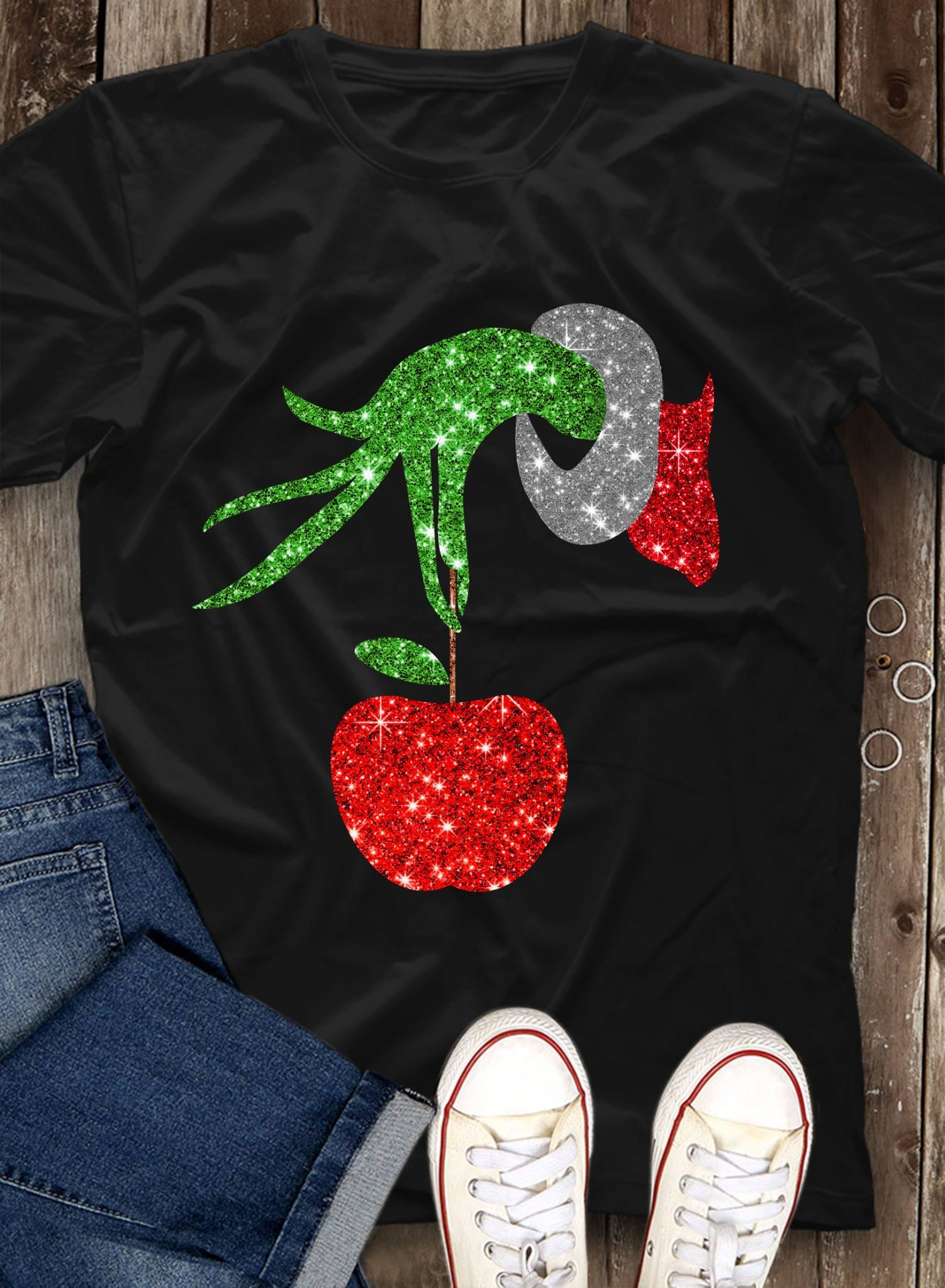 The Grinch holding an apple ornament shirt