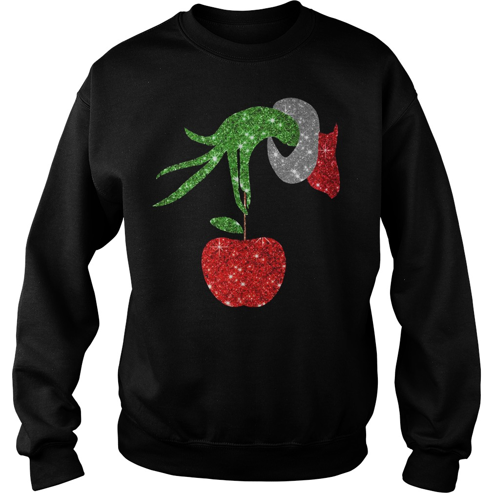 The Grinch holding an apple ornament Sweater