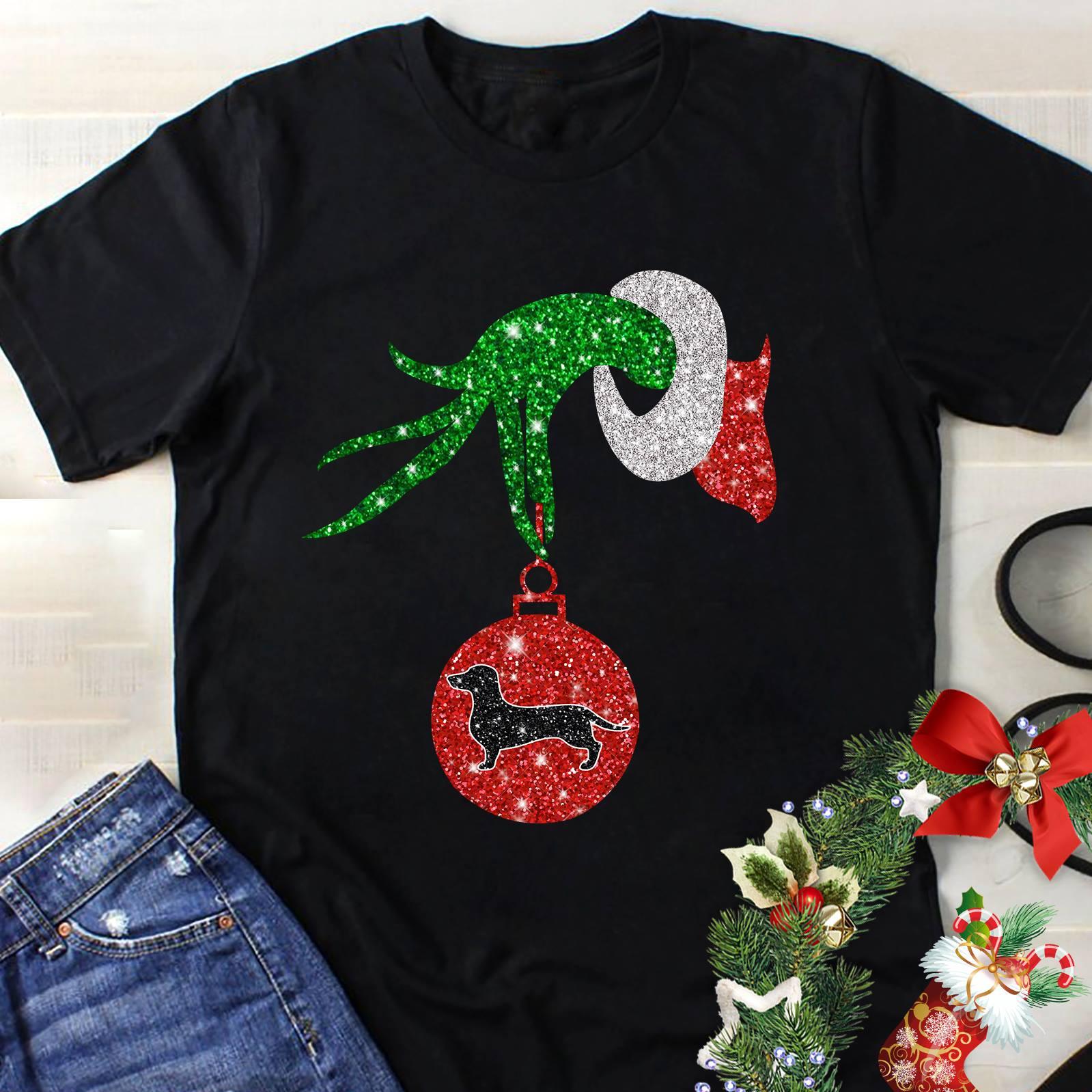 The Grinch holding a dachshund ornament shirt